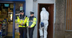 Gardaí at the scene on Popham's Road, Cork where a woman's body was found. Photograph: Michael Mac Sweeney/Provision