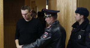 Russian opposition leader Alexei Navalny enters a court room to hear his verdict at the Tverskoy district court in Moscow, Russia. Photograph: Sergei Ilnitsky/EPA