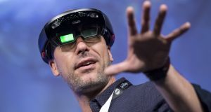 Facundo Diaz, co-founder and chief executive officer of Vrtify, wears a pair of Microsoft HoloLens glasses  at the SXSW Interactive Festival earlier this month