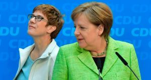 State premier of Saarland Annegret Kramp-Karrenbauer with Germany's chancellor Angela Merkel after their party, the CDU, emerged as the big winner in the state election. Photograph: John MacDougall/AFP/Getty Images