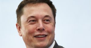 Tesla founder Elon Musk has a new firm that  aims to implant tiny brain electrodes that may one day upload and download thoughts. Photograph: Bobby Yip/Reuters