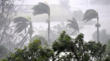 Destructive Cyclone Debbie hits north Australia