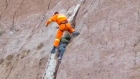 Firefighters rescue a child from a cliff crevice 40m above ground