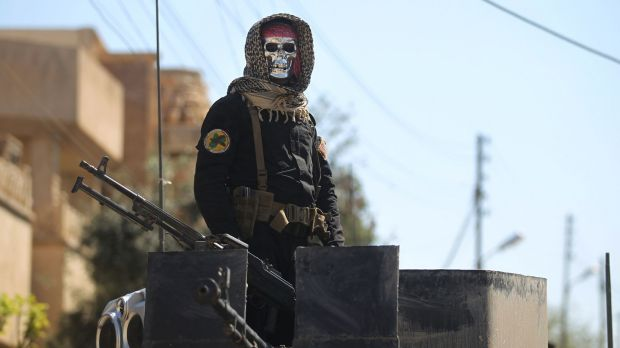 An Iraqi counter terrorism forces member stands guard in Mosul's al-Jadida area on Sunday. Photograph: Ahmad al-Rubaye/AFP/Getty Images