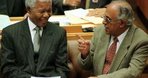 Ahmed Kathrada with former South African president and fellow Robben Island prisoner  Nelson Mandela  in Cape Town in 1999. Photograph: Reuters