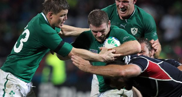 Ireland's Gordon D'Arcy supported by Brian O'Driscoll and Paul O'Connell during the 2011 Rugby World Cup match against USA. Photo: Bill Stickland/Inpho