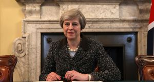 British prime minister Theresa May  signs the article 50 letter, as she prepares to trigger the start of the UK's formal withdrawal from the EU on Wednesday.  Photograph: Christopher Furlong/PA Wire