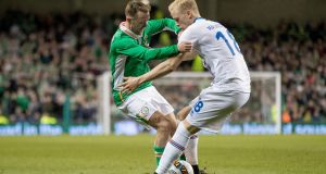 Aiden McGeady battles for the ball with Iceland's  Aron Einar Gunnarsson during the friendly international at the Aviva Stadium. Photograph:  Morgan Treacy/Inpho