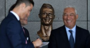 Cristiano Ronaldo attends the unveiling of a bust  in his honour  at the ceremony at Madeira Airport to rename it Cristiano Ronaldo Airport. Photograph: Octavio Passos/Getty Images