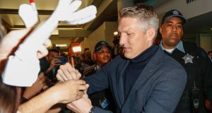Bastian Schweinsteiger  signs autographs after arriving at  O'Hare International Airport in Chicago. The former German international has signed a deal with MLS club Chicago Fire. Photograph:  Kamil Krzaczynski/EPA