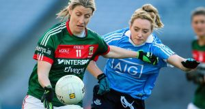 Cora Staunton of Mayo and Dublin's Fiona Hudson during the Senior Ladies National Football League game at Croke Park last Sunday. Photograph: Gary Carr/ Inpho.