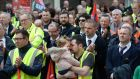 Raymond Doyle, Ashbourne, Co Meath, with his daughter Daisey-Ray (17 months) and striking Bus Éireann workers  outside Leinster House on Wednesday. Photograph: Dara Mac Dónaill