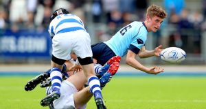 Blackrock College's Sam Small and Adam Dixon tackle Oscar Hurley of St Michael's College in the Bank of Ireland Leinster Schools Junior Cup final replay in  Donnybrook. Photograph: James Crombie/Inpho