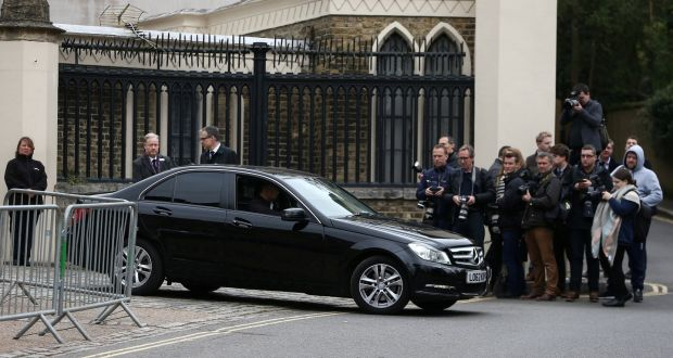 A Car Drives Past Members Of The Media Outside Highgate Cemetery In London England