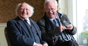 President Michael D Higgins with poet Brendan Kennelly at a reception in the Shelbourne Hotel on St Stephen's Green, Dublin, where he received the inaugural Kerry Association in Dublin Arts Award. Photograph: Julien Behal