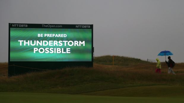 A sign warns of an approaching thunderstorm at the 2014 British Open. Photo: Getty Images