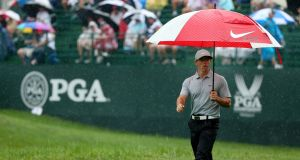 Rory McIlroy walks up the 16th hole in heavy rain during the second round of the 2014 USPGA Championship at Valhalla Golf Club in Louisville, Kentucky. Photo: Mike Ehrmann/PGA of America via Getty Images