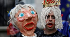 A protester in London holds an effigy of Britain's prime minister Theresa May during an anti-Brexit demonstration in London, England. Photograph: Peter Nicholls/Reuters