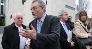 Ian Bailey (centre) at the Criminal Courts of Justice in Dublin. Also pictured are (L to R) filmmaker Jim Sheridan,  Bailey's solicitor Frank Buttimer and  Bailey's partner Jules Thomas. Photograph: Collins Courts.