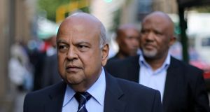 Pravin Gordhan: South Africa's finance minister and his deputy, Mcebisi Jonas, head into  to a court hearing in Pretoria. Photograph: Siphiwe Sibeko/Reuters