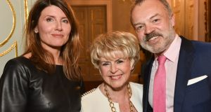 Actor and Catastrophe writer Sharon Horgan, presenter Gloria Hunniford and BBC chat show host Graham Norton at the event honouring Ms Hunniford at the Irish embassy in London on Thursday night.