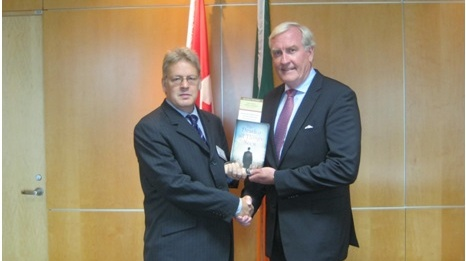 Dr Jason King presents a copy of Michael Collins' The Death of All Things Seen to Kevin Michael Vickers, Canada's Ambassador to Ireland