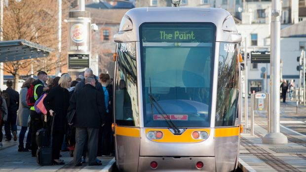 Commuters waiting board a Luas tram following secondary picketing linked to the Bus Éireann strike at Heuston Station, Dublin. Photograph: Gareth Chaney/Collins