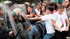 Venezuelan opposition activists scuffle with national guardsmen during a protest in front of the supreme court in Caracas on Friday. Photograph: AFP/Getty Images
