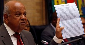 """Complete nonsense"": Former finance minister Pravin Gordhan with the intelligence report  president Jacob Zuma used to justify firing him. Photograph: Siphiwe Sibeko/Reuters"