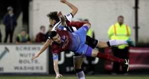 Dundalk's Jamie McGrath collides with Gavin Brennan of Drogheda. Photo: Morgan Treacy/Inpho