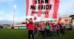 Members of the Derry City FC Cubs who released balloons in memory of club captain Ryan McBride prior to kick off. Photo: Lorcan Doherty/Inpho