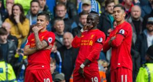 Liverpool's Philippe Coutinho celebrates his goal with Roberto Firmino and Sadio Mane at Anfield. Photograph: PA