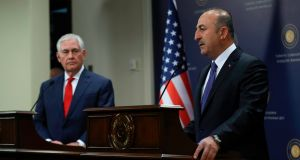 US secretary of state Rex Tillerson  with Turkish foreign minister Mevlut Cavusoglu   in Ankara. Tillerson said  the Syrian people would decide the future of President Bashar al-Assad. Photograph: Adem Altan/AFP/Getty Images