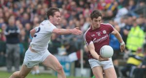Shane Walsh on the ball against Kildare on Sunday. He will be playing in Division One next year. Photograph: Inpho