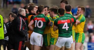Mayo and Donegal players clash during a tempestuous encounter in Castlebar. Photograph: Tom Beary/Inpho