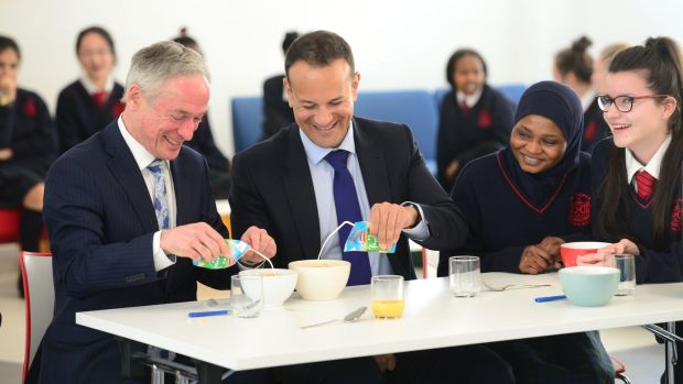 Ministers Richard Bruton and Leo Varadkar with students at the announcement of expansion of the School Meals Scheme 2017. Bruton said 79 schools were to be added into the Deis programme. Photograph: Dara Mac Dónaill