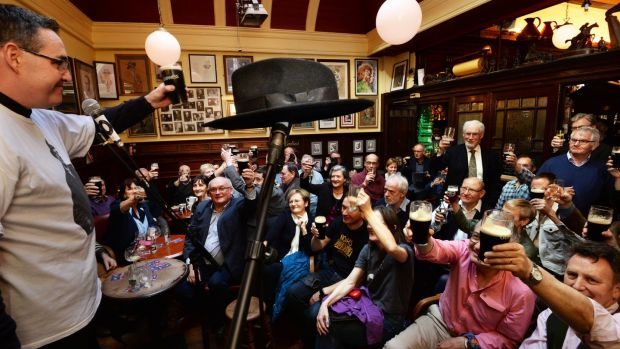 John Clarke raises a glass to Brian O'Nolan on the 50th anniversary of the publication of The Third Policeman on Mylesday at The Palace Bar in Dublin. Photograph: Cyril Byrne / The Irish Times