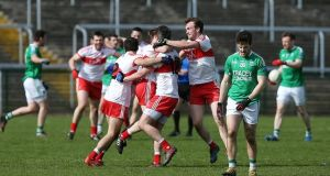 Derry celebrate their last-gasp win over Fermanagh but victory wasn't enough to keep them in Division Two. Photograph: John McVitty/Inpho