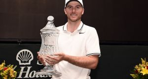 Russell Henley poses with the trophy after winning the Shell Houston Open in Humble, Texas. Photograph: Stacy Revere/Getty Images