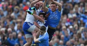 Monaghan's Gavin Doogan, Darren Hughes and Neil McAdam with Paul Flynn and Brian Fenton of Dublin during Sunday's Allianz Football League Division 1 semi-final at Clones, Co Monaghan.  Photograph: Tommy Grealy/Inpho