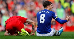 Everton's Ross Barkley pleads his innocence after committing a dangerous foul on Liverpool's Dejan Lovren at Anfield. Photograph: Phil Noble/Reuters