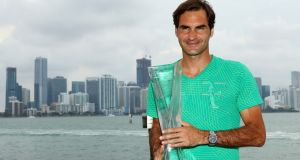 Roger Federer poses in front of the Miami Skyline after defeating Rafael Nadal in the men's final of the Miami Open. Photo: Al Bello/Getty Images