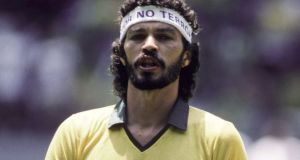 "Brazil captain Sócrates at the 1986 World Cup with a headband ""Yes to Love, No to Terror,"" a response to the recent US bombing of Libya. Photograph: Bongarts/Getty Images"