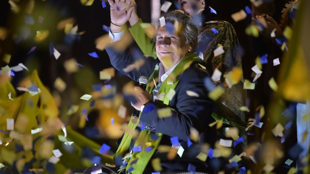 Ecuadorean presidential candidate of the ruling Alianza PAIS party, Lenin Moreno, waves to his supporters as they waited for the final results of the run-off election in Quito on Sunday. Photograph: Rodrigo Buendia/AFP/Getty Images