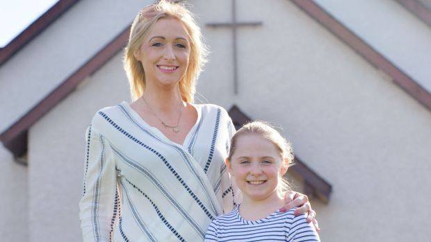 Bronwyn Cuddy with her daughter, Claudia, who will be making her communion this year at St Edmund's Church, Castletown, Co Laois. Photograph: Alan Betson