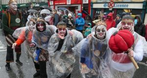 Performers add a dash of colour in the rain during this year's  St Patrick's Day Parade in Galway city. Photograph: Joe O'Shaughnessy