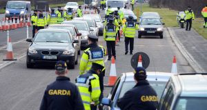 Gardaí inspect vehicles at a checkpoint in Co Dublin. Under new proposals it appears the full-strength capability would be slimmed down to 600 members. File photograph: Eric Luke/The Irish Times