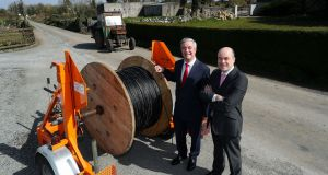 Minister for Communications Denis Naughten (right) with the CEO of Eir Richard Moat in Ardnanure, Co Roscommon. Mr Naughten confirmed an additional 300,000 homes and businesses would have access to high-speed broadband offering 1,000Mb/s within 90 weeks. Photograph: Maxwellphotography.ie