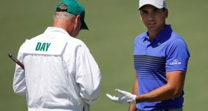 Jason Day of Australia talks with his caddie Colin Swatton on the second hole during Tuesday's practice round at Augusta National. Photograph: Reuters