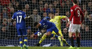 Everton's Ashley Williams handles the ball in the penalty area, resulting in a late penalty at Old Trafford. Photograph: Inpho